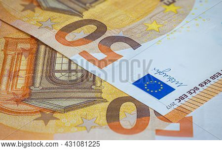 Close Up On 50 Euro Banknote With The European Flag. Euro, Currency Of European Union. Financial Bac