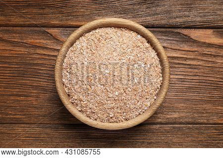 Bowl Of Wheat Bran On Wooden Table, Top View