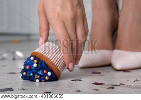 Woman Picking Up Dropped Cupcake From Floor, Closeup. Troubles Happen