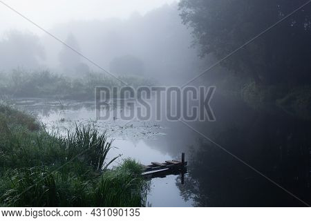 Small Homemade Pier In The Village For Boats And Fishermen On The Fantastic Foggy River At The Sunri