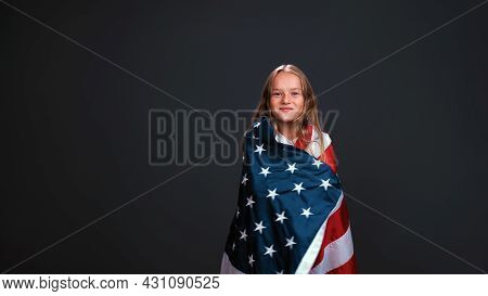 Little Girl Patriot Wrapped In A Usa Flag Celebrates Independence Day Expresses Patriotism Isolated