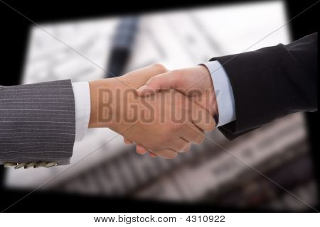 Businesswoman Handshake Over Signed Contract Document