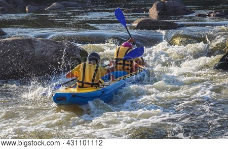 Two Man Roving Inflatable Kayak On Whitewater Of Mountain River. Concept: Summer Extreme Water Sport