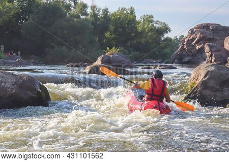A Man Rowing Inflatable Packraft On Whitewater Of Mountain River. Concept: Summer Extreme Water Spor