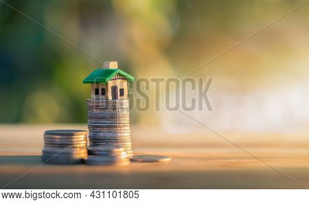 House Placed On Coins. Planning Savings Money Of Coins To Buy A Home Concept, Concept For Property L