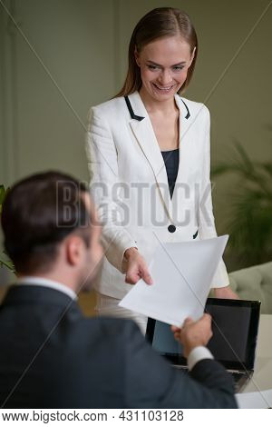 Young Woman Brought A Documents To A Coworker And Making A Young Man A Bait. Two Young And Attractiv