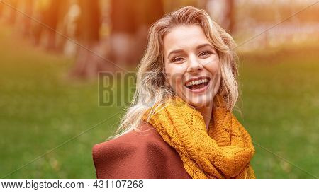 Joyful Young Woman In Autumn Coat And Yellow Knitted Scarf Standing Joyful Smiling In The Fall Yello