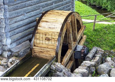 The Wheel Of An Old Water Mill. A Village Water Mill, The Wheel Of Which Rotates Under The Influence