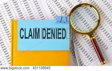 Claim Denied Text On Sticker On Notebook With Magnifier And Chart. Business