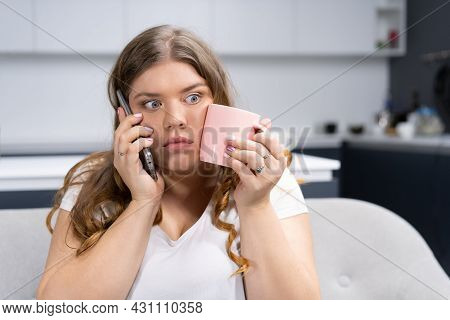 Shocked Or Surprised Look Overweight Young Woman Talking On The Phone With Boss Or Friends Holding A