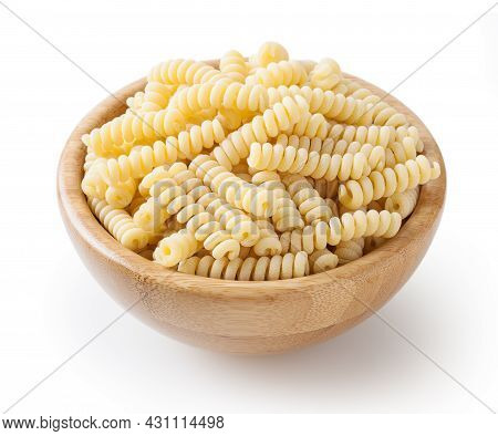Uncooked Fusilli Corti Bucati Pasta In Wooden Bowl Isolated On White Background With Clipping Path