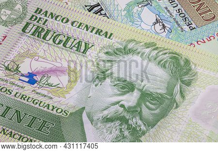 Close Up To Uruguayan Peso Of The Republic Of Uruguay. Polymer Banknotes Of South American Country.