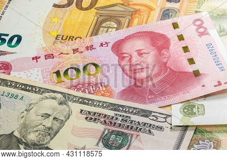 Close Up To Hundred Yuan Of The People Republic Of China Laying Between 50 Us Dollar And 50 Euro Ban