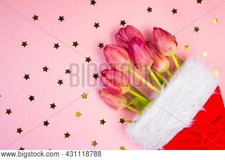Santa Claus Christmas Hat With Tulips Inside. New Year Christmas, Gifts
