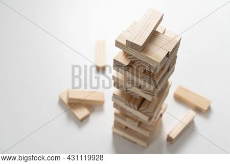 Closeup Wood Blocks Stack Game For Planning, Risk And Strategy Of Project Management In Business Con