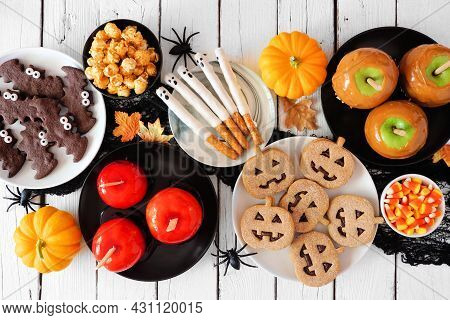 Traditional Halloween Treat Table Scene Over A White Wood Background. Top View. Group Of Candied App