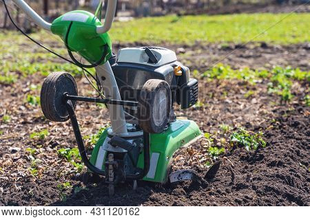 Cultivator For Cultivating The Soil In The Garden.