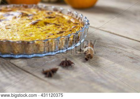 Fresh Pumpkin Pie. Pumpkin Pie. Pie On A Brown Wooden Table. Copy Space