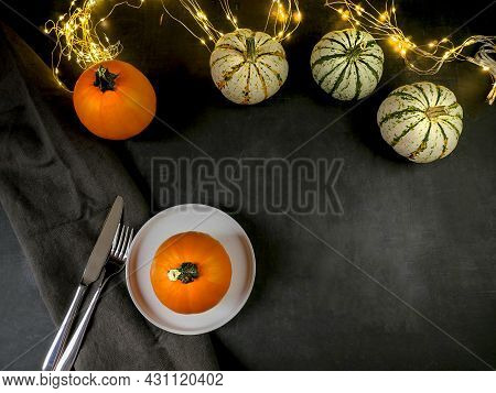 Thanksgiving Day. Festive Table. Pumpkins And Lighted Lights. View From Above
