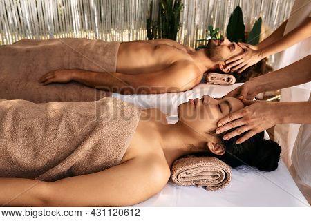 Anti-stress Head Massage For A Loving Couple At Resort, Close Up. Beautiful Couple Getting Head Mass