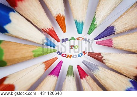 Group Of Coloured Pencils Arranged In A Circle With The Tips Pointing Inwards,  With The Meassage Ba
