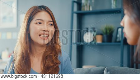 Asia Housewife Women With Casual Relax On Couch With Cup Of Tea Talk Together About Their Life And H