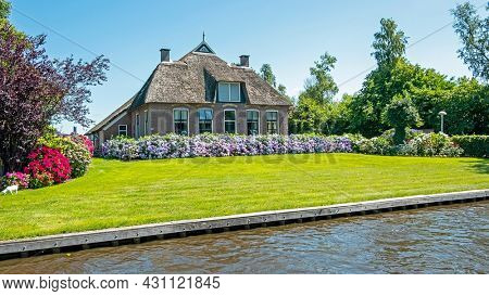 Traditional farmers house in the countryside from the Netherlands in summer
