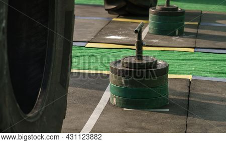 Barbells Weights On Vertical Bar With Handles On Stadium Rubber Floor On Iron Man Competition In Ukr