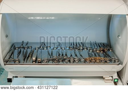 Medical Ultraviolet Sterilizer. Medical Autoclave With Instruments. Proctology
