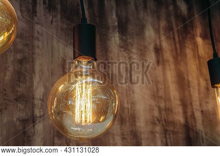 Retro Incandescent Lamp With Warm Light. Vintage Glowing Light Bulb.
