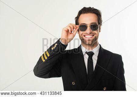 Smiling Aviator Holding Sunglasses Isolated On White