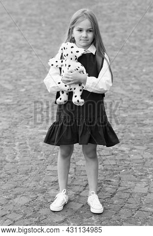 Caring Is More Gaining. Little Child In School Uniform Hold Toy Dog Outdoors. Pet Animal. Friends An