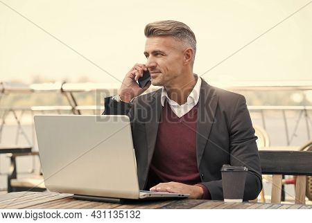 Remote Management. Online Service Manager Work In Internet Cafe. Sales Manager Make Phone Call To Cl