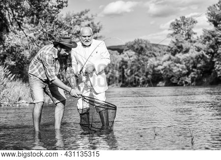 Happy Fishermen Friendship. Catching And Fishing Concept. Two Male Friends Fishing Together. Retired