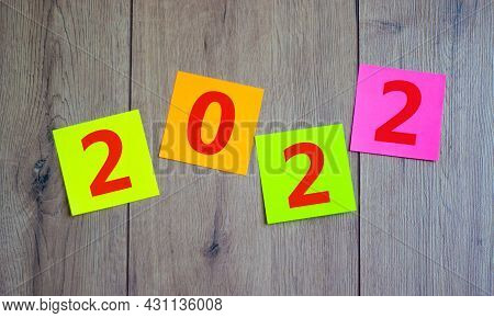 2022 Happy New Year Symbol. Colored Paper With Number 2022 Symbolize The Change From 2021 To The New