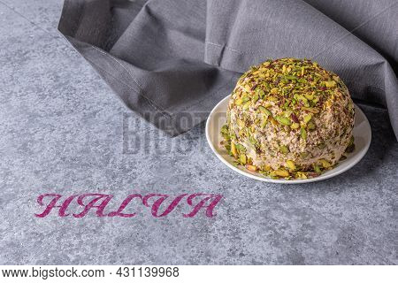Halva With Pistachios On Gray Stone Background With Gray Linen Napkin On Side And Halva Pink Text. T
