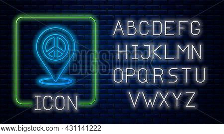 Glowing Neon Location Peace Icon Isolated On Brick Wall Background. Hippie Symbol Of Peace. Neon Lig