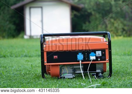 Portable Electric Generator On The Backyard Of A Summer House Outdoors