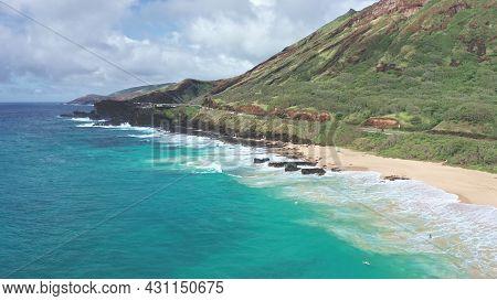 Flight Over Rocky Coast Of Tropical Island Of Oahu Hawaii. View Of Sandy Beach. Kalanianaole Highway