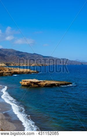 detail of Playa de la Galera beach, in Aguilas, in the Costa Calida coast, Region of Murcia, Spain, with the Calnegre mountain range in the background