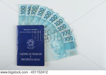 Bahia, Brazil. Agosto 27, 2021. Brazilian Work Card (carteira De Trabalho) And Brazilian Money. Tran