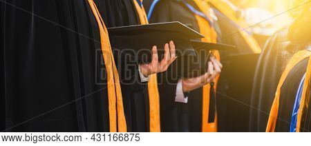 Close Up Graduate Holding A Hat. Concept Success Education In University With Copy Space.