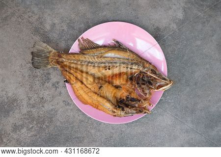 Close Up Deep Fried Fish (sea Bass) With Fish Sauce On The Pink Plate. This Is Recommended Dish Of T
