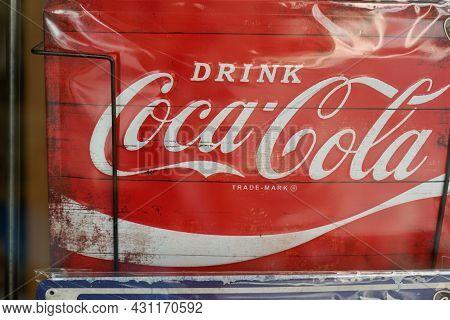 Bordeaux , Aquitaine  France - 08 25 2021 : Coca Cola Vintage Retro Drink Advertisement Sign Logo An