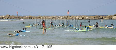 Tel Aviv, Israel - August 15th, 2021: A Beginners Surfing Lesson For A Group Of Children, Off The Sh