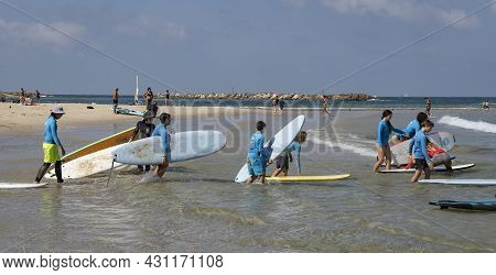 Tel Aviv, Israel - August 15th, 2021: A Beginners Surfing Lesson For A Group Of Children, On The Tel