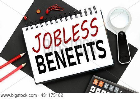 Jobless Benefits. White Sheet Of Paper On Black And White Background With Red Arandashes