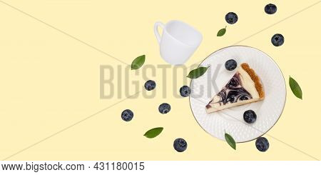 A Piece Of Blueberries Cheesecake On A Falling White  Ceramic Plate With Falling White Ceramic Cup.