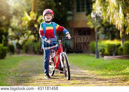 Boy Going To School On Bike. Kids Ride Bicycle.