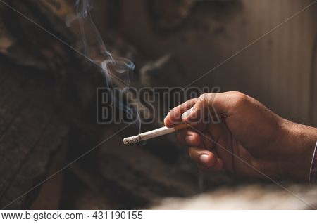Close Up Male Hand Holding A Cigarette.